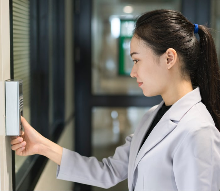 woman reaching a digital fingerprint locker