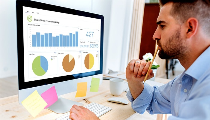 Man viewing marketing trends with Cognos Analytics