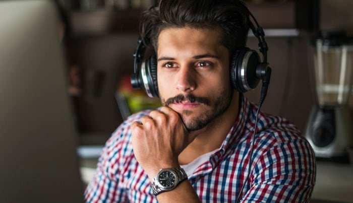 man listening with headphones