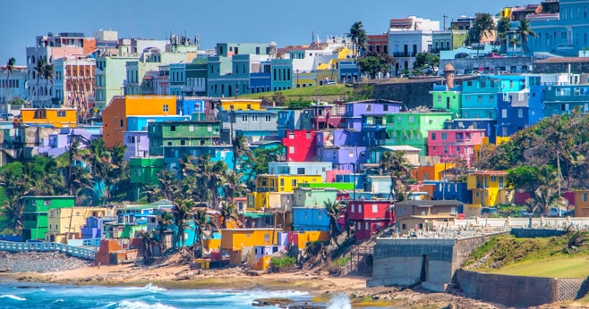 Colorful houses on a hilly beach in Puerto Rico to represent government of Puerto Rico case study