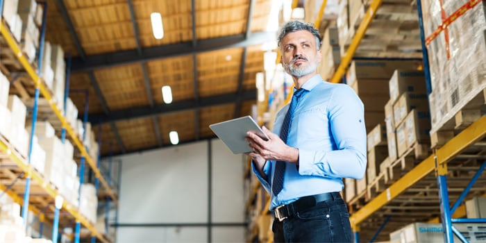 Man in warehouse with a tablet
