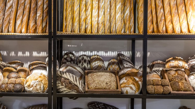 A variety of baked goods displayed in a bakery window