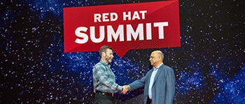 Two men shaking hands at Red Hat Summit