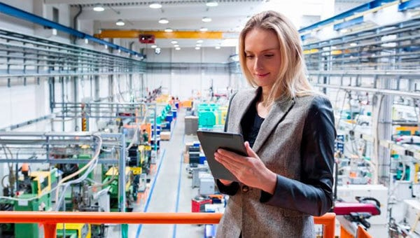 Woman using a tablet on a supply chain