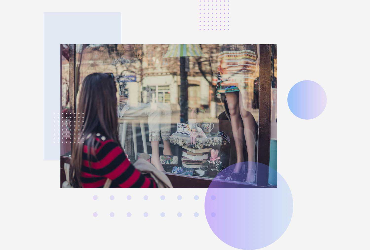 woman looking through glass storefront