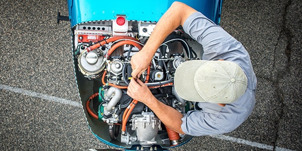 Man working on motor