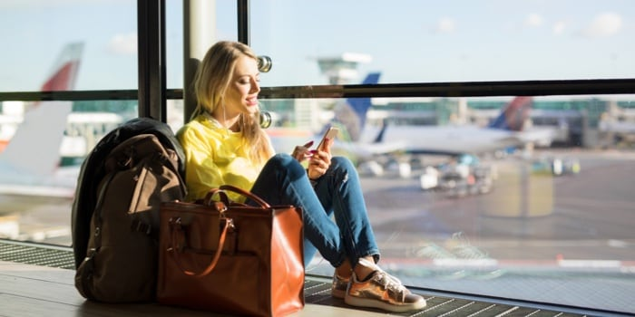 A woman sitting at the airport