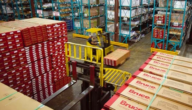 A distribution warehouse with shelves and boxes waiting for distribution representing JJ Haines and Company