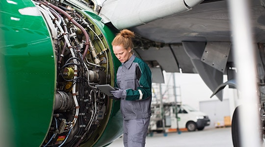 woman working on aircraft engine