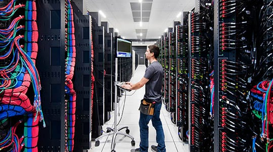 Man standing in datacenter