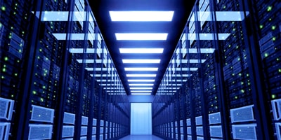 Hallway lined with servers in blue light