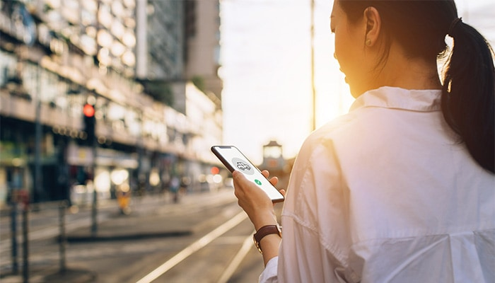 woman using a smartphone on the street