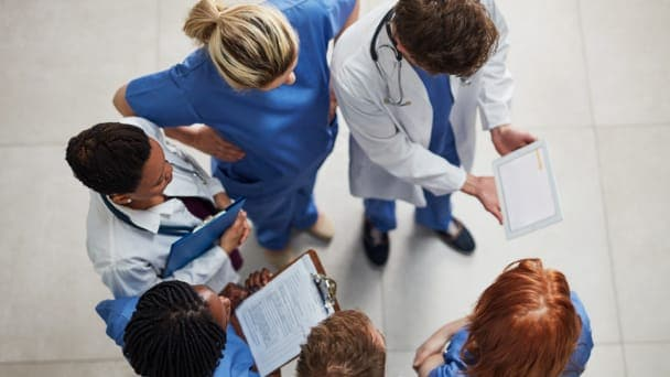 Overhead shot of doctors and nurses working together