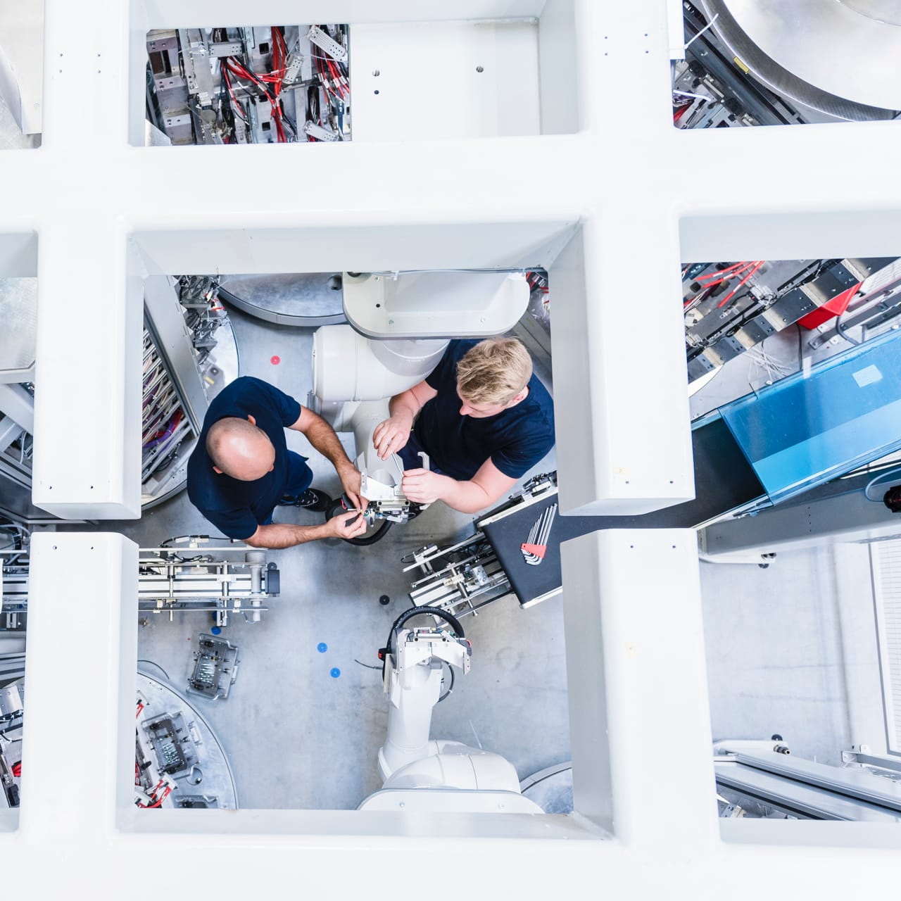 Overhead shot of two men implementing robotic processes