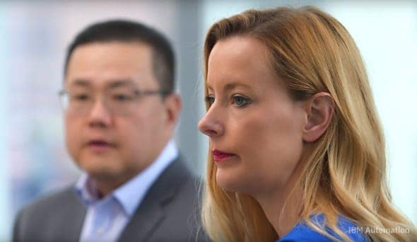 Closeup image of two businesspeople listening