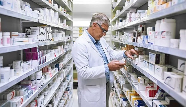 Pharmacist in drugstore aisle image representing and IBM storage case study of Pharmaoverseas