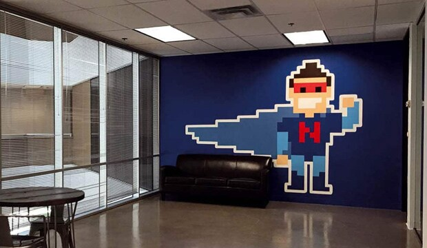 office room with a superhero painted on the wall