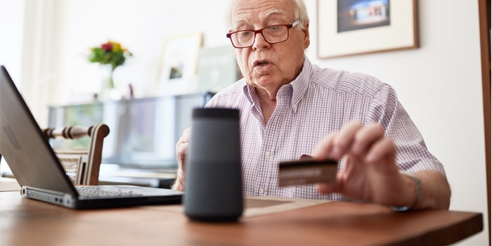 An elder looking at his credit card