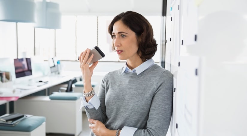 Business person speaking into cell phone