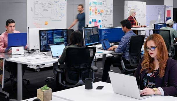 Photo of developers at computers in an open-plan office