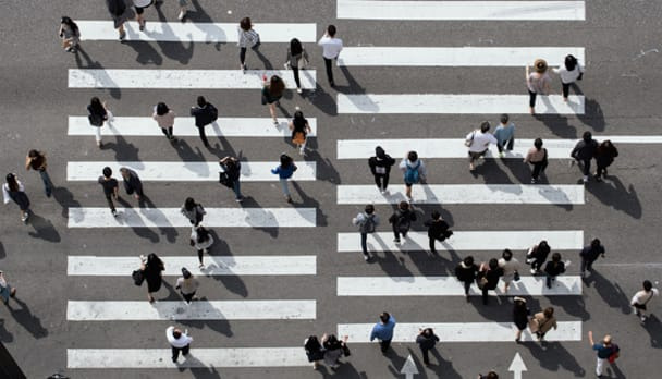 Overhead photo of people on a crosswalk to convey efficiency