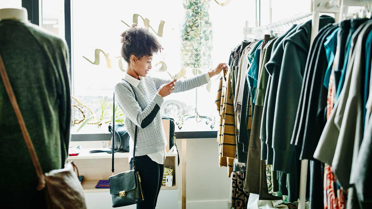 Woman browsing clothes and using a smartphone
