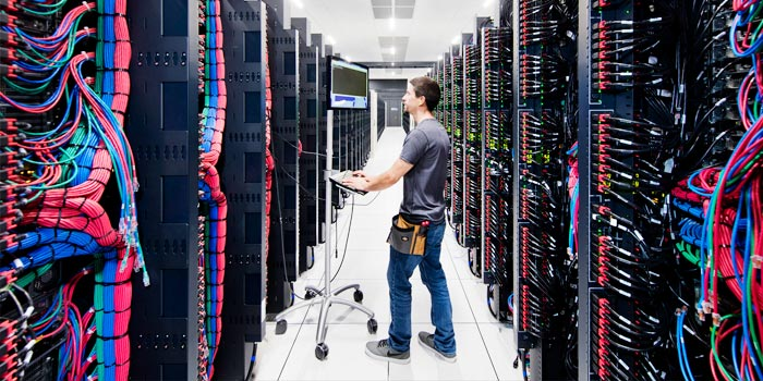 Man working in a large server room