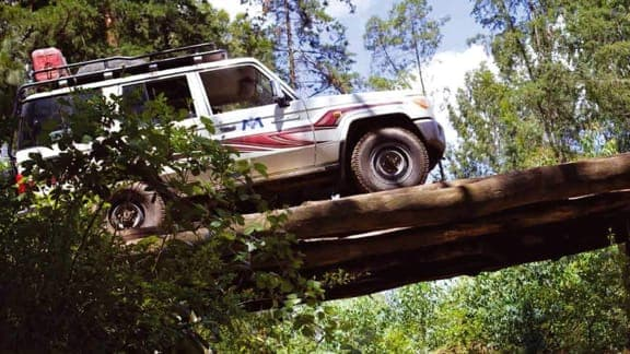Special Utilities Vehicle crossing a log bridge