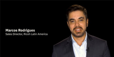 Photo of Marcos Rodrigues (dressed in suit), Sales Director, Ricoh Latin America