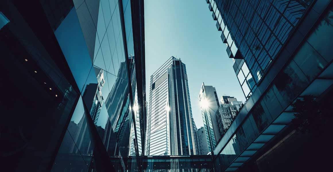 City skyline reflecting sunlight