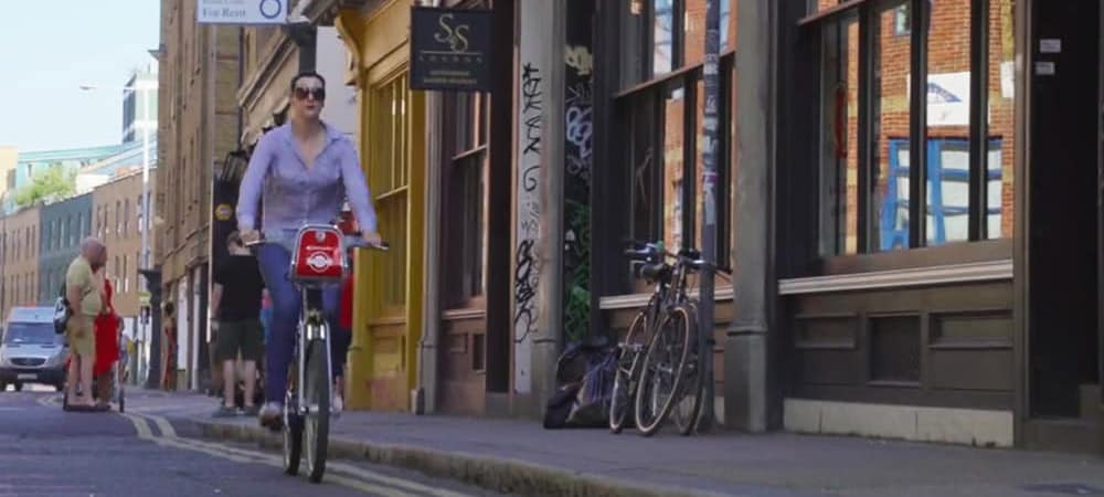 woman cycling on the street