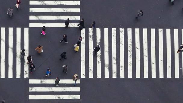 Aerial view of people crossing an avenue