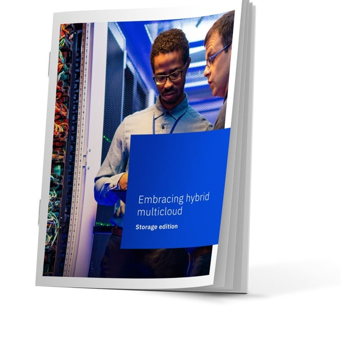 Cover of ebook about embrasing hybrid multicloud with Two IT specialists in a data center reviewing storage units