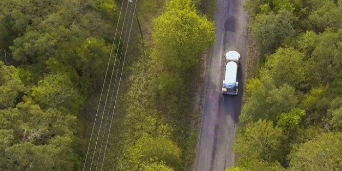 aerial view of a road with a truck