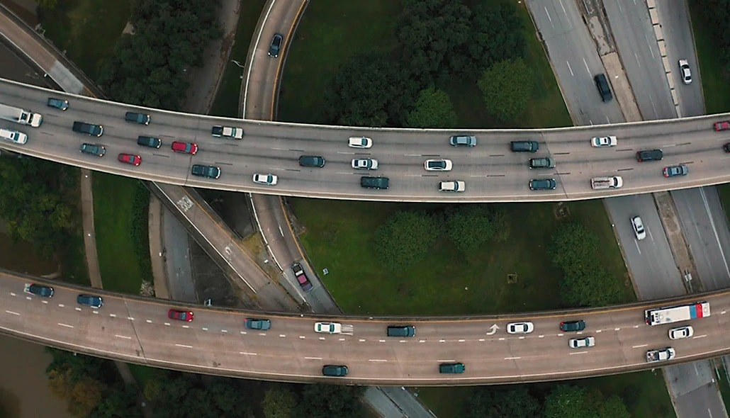 Aerial view of vehicles on an overlapping network of highways