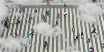 A view from above of people crossing the street