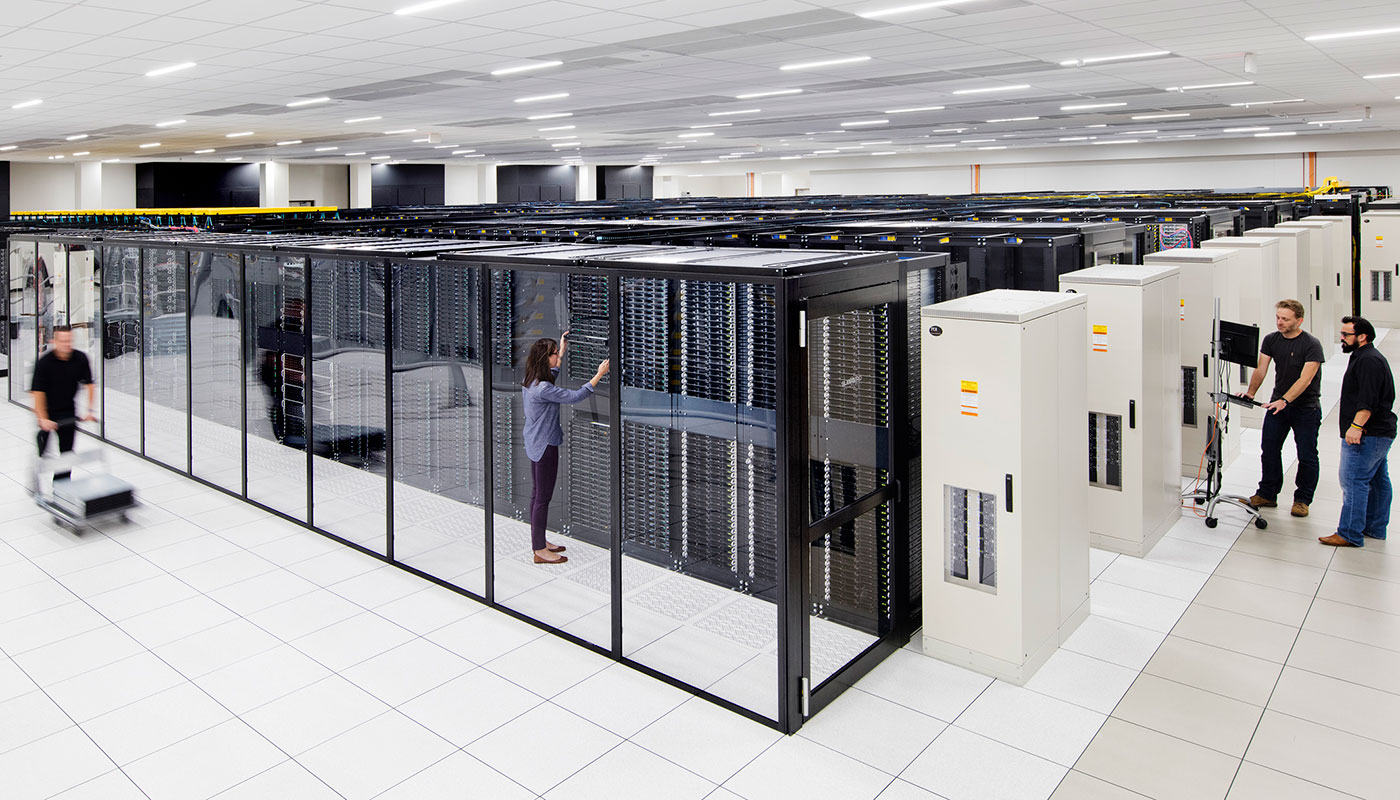 some people around a mainframe room