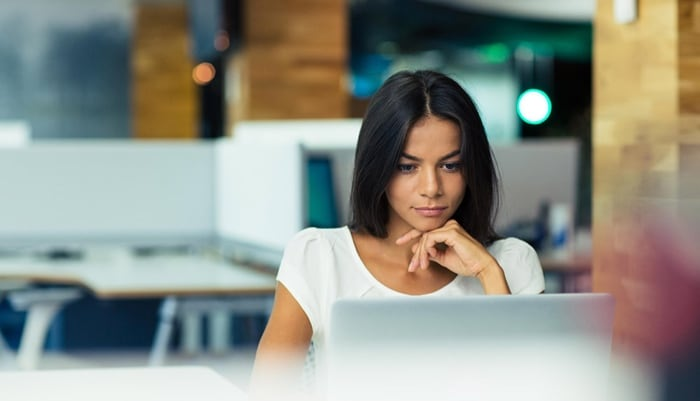 woman on laptop in corptorate office
