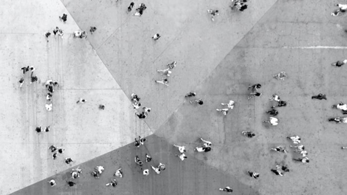 Top view of people walking in a courtyard