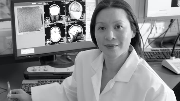 Healthcare provider standing in front of computer workstation