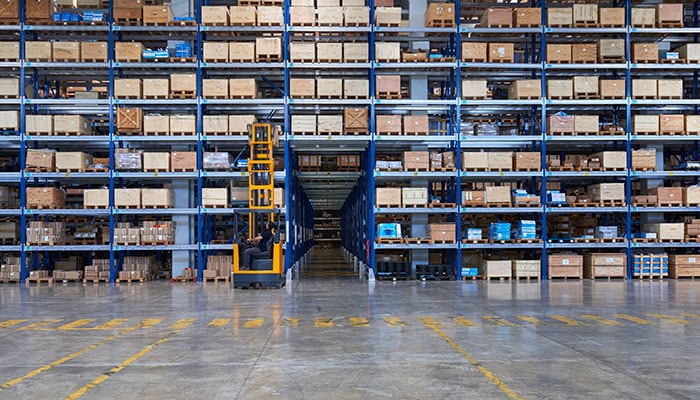 warehouse with stacked rows of boxes.