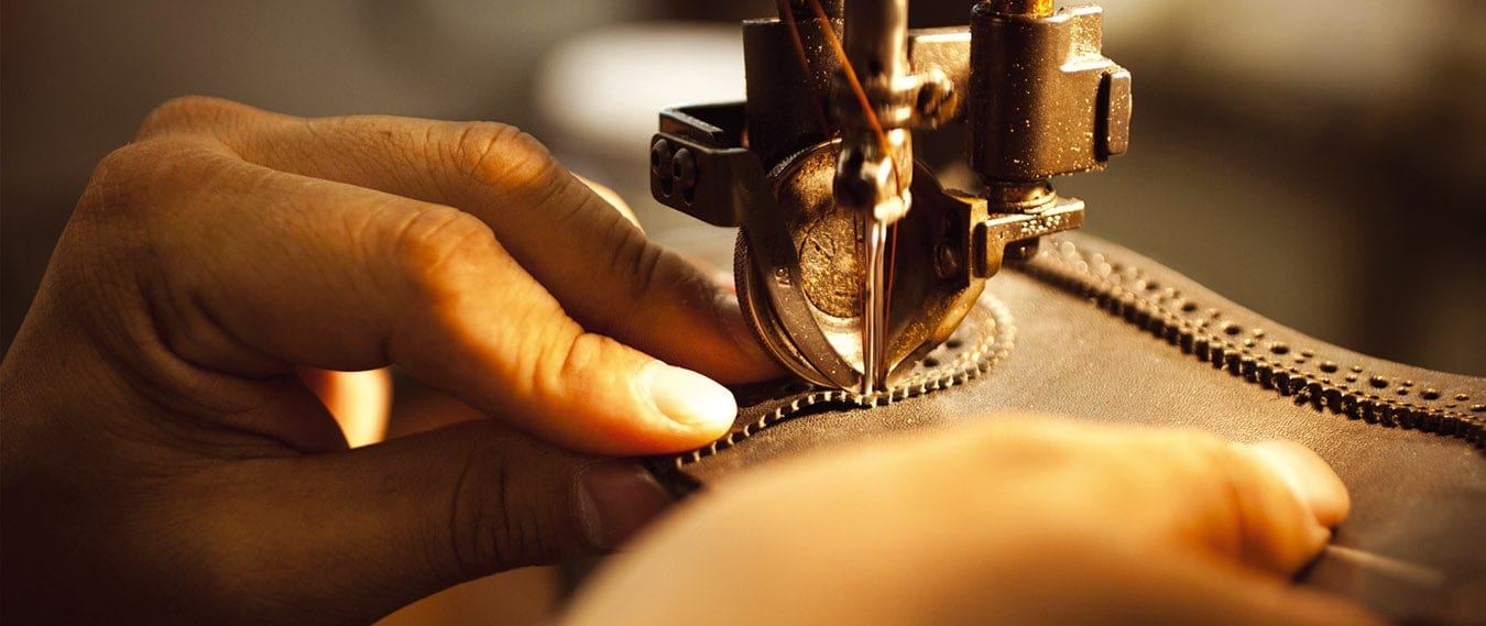 Hands working a sewing machine