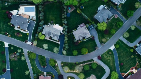 Overhead view of a winding road in a suburban neighborhood