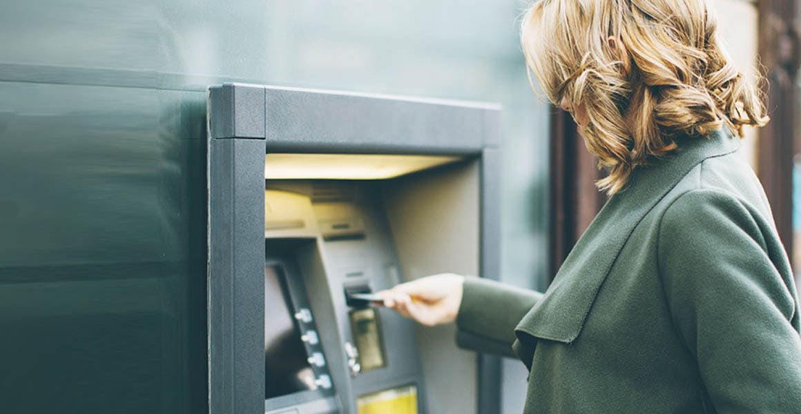 woman operating an ATM machine