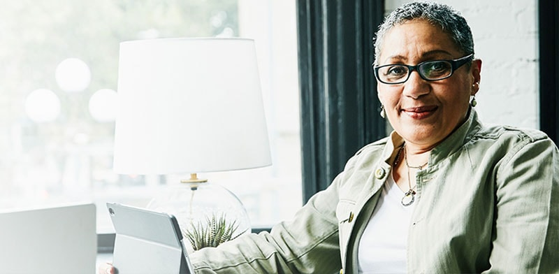 A business woman hosts a virtual meeting