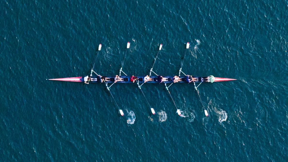 nine rowers on boat