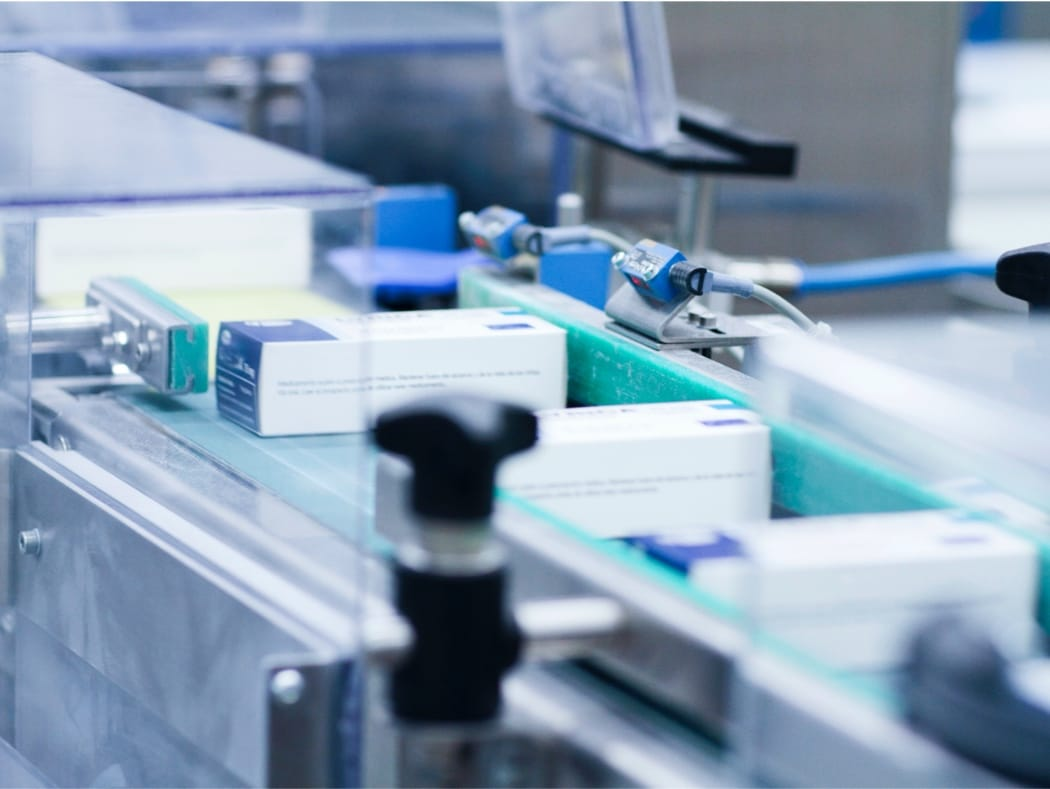 Close up of automated pharmaceutical packaging line