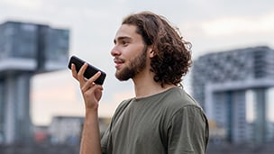 a man speaks into his mobile phone