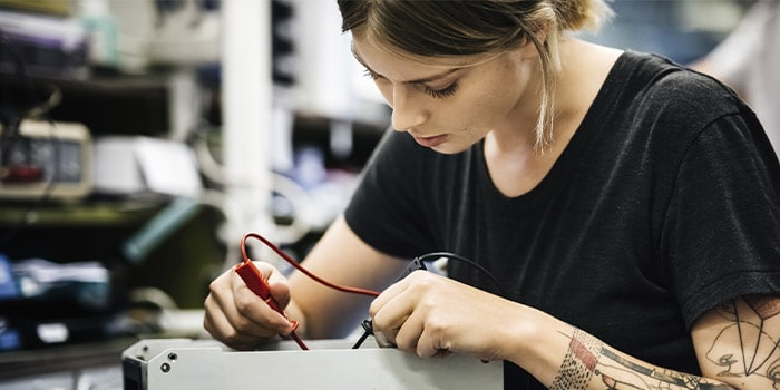 Woman performing diagnostics on a piece of hardware