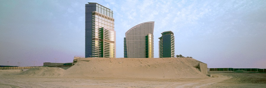 Modern buildings set in a sparse landscape